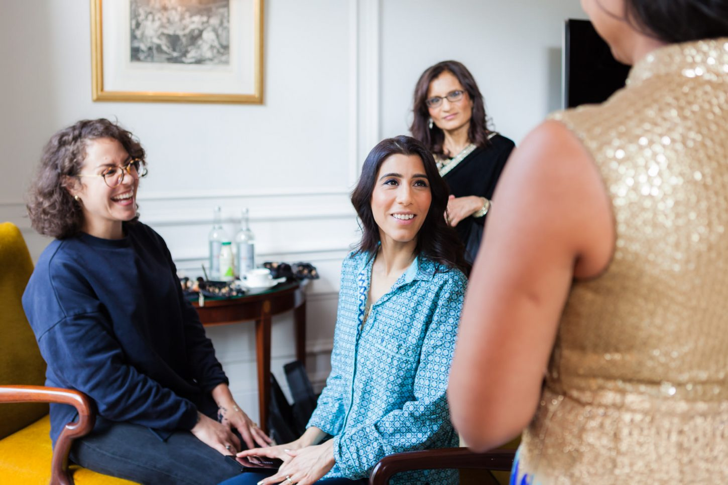 A bride to be is smiling with other joyful women at Mandarin Oriental Hotel in London.