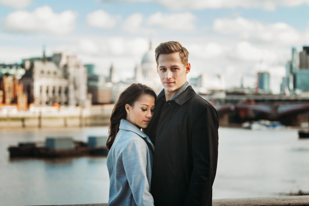 A sweet couple is posing for their pre-wedding photo shoot in London, UK.