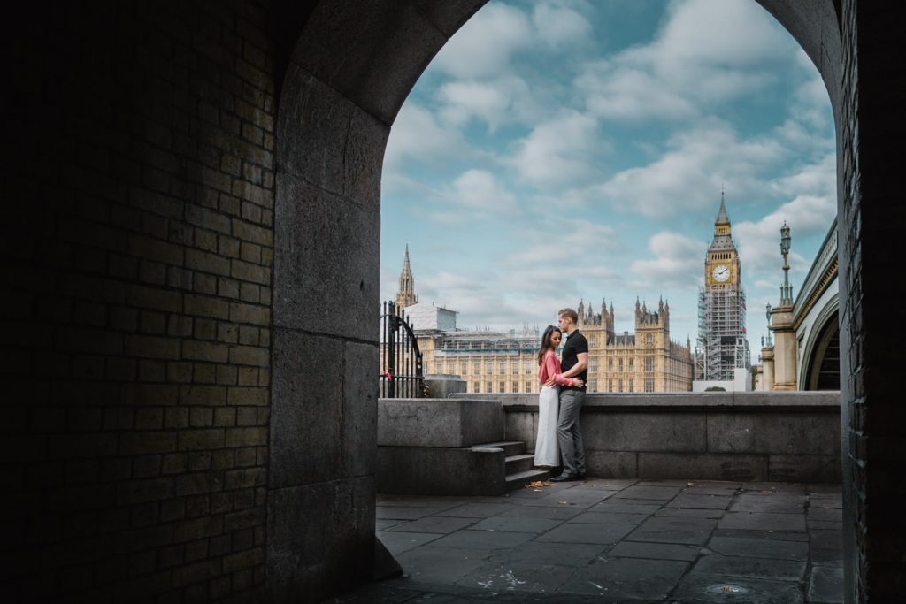 The newly engaged couple is posing sweetly for their pre-wedding photo shoot near the London Clock Tower.