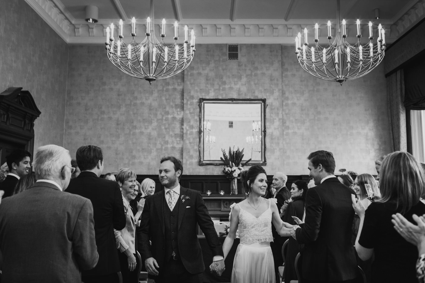 A black and white photo of a newlywed couple celebrating their wedding day with the guest at Bloomsbury House in London